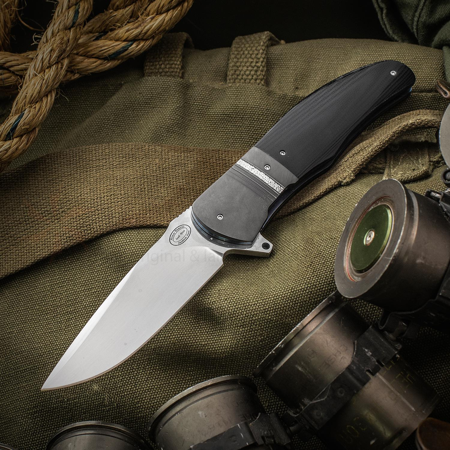 Herucus Blomerus Custom LL 13 Flipper 3.625 inch N690 Hand Rubbed Satin Blade, Black G10 Handles with Textured Zirconium Bolsters