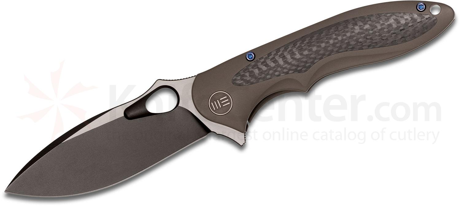 We Knife Company 716C Zephyr Flipper 3.48 inch M390 Black Two-Tone Blade, Brown Titanium Handles with Carbon Fiber Inlays