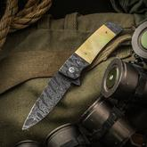 Butch Ball Custom Flipper 3.375 inch Nichols Blackout Damascus Blade, Gold Mother of Pearl Handles with Dual Damascus Bolsters and Clip