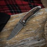 Chris Reeve Mnandi Folding Knife 2.75 inch Thomas Ladder Damascus Blade, Titanium Handles with Macassar Ebony Inlays